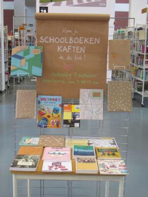 Kaft je schoolboeken in de bib